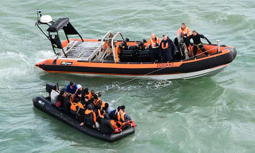 Twenty migrants in an inflatable dinghy that ran out of fuel while trying to cross the Channel. They were rescued by French coast guards off the coast of Graveline and Cap Griz-Nez on 5 August.