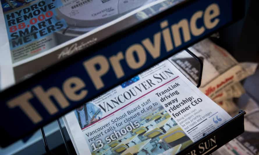 newspaper stand with the province and vancouver sun
