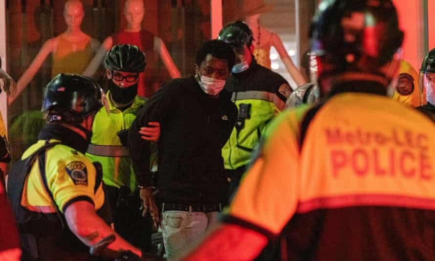 Police make an arrest in Boston on the night of 31 May.
