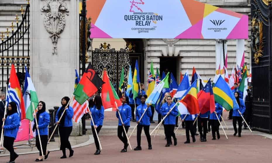 School students carry the flags of the Commonwealth countries after the Queen launched the baton relay for the Birmingham 2022 Games.