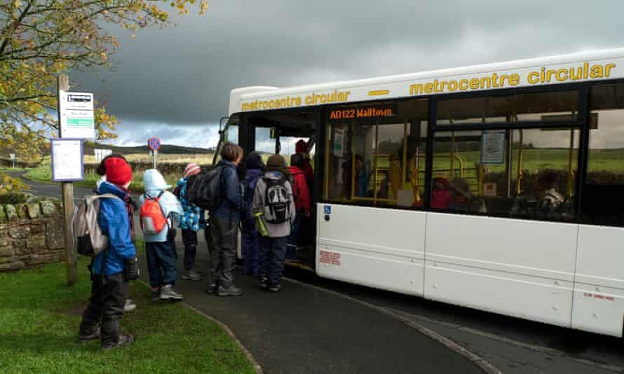 Schoolchildren tour group boarding an AD122 bus near Hadrian's Wall, Northumberland, England.