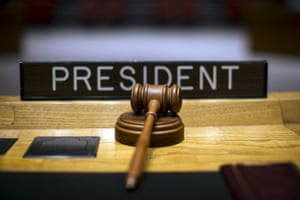 The president's gavel lies on the security council's circular table.