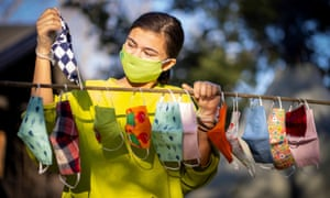 Yuni Cheng Wiik, 16, shows off protective face masks that she sewed for friends in Nesodden, Norway