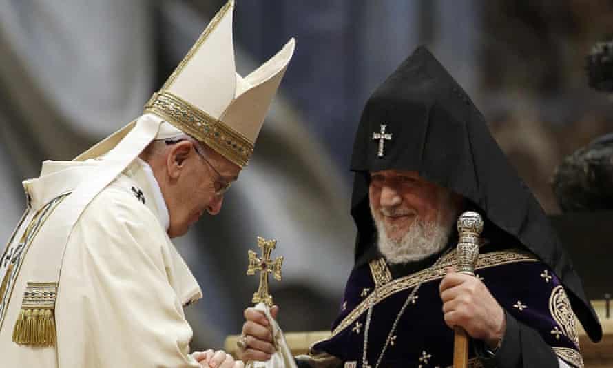 Pope Francis and the head of Armenia's Orthodox church, Karekin II, greet each other during an Armenian-rite mass in St Peter's Basilica