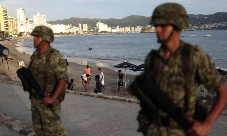 Soldiers stand guard in Acapulco. Critics say the new law will cement a failed strategy of using soliders to combat drug cartels.