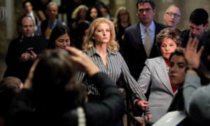 Summer Zervos, a former contestant on The Apprentice, leaves New York supreme court with attorney Gloria Allred on 5 December 2017.