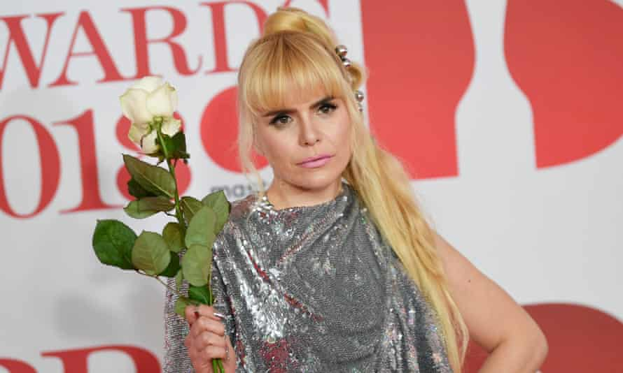 Paloma Faith holding a white rose at the 2018 Brit Awards.