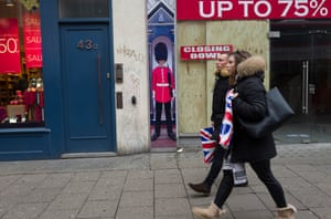 Tourists with Union Jack carrier bags. Economists have warned that a 'no deal' Brexit could add £930 a year to UK shopping bills