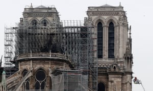 Firefighters worked to put out residual fires at Notre Dame early on Tuesday.