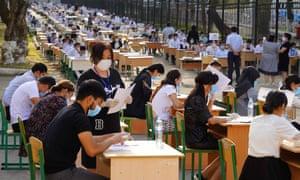 Students attend the university entrance examination at an outdoor exam site in Tashkent, Uzbekistan, on Wednesday.