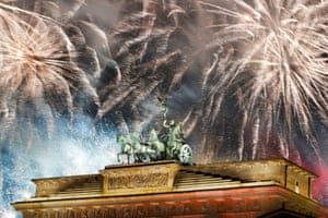Fireworks explode over the Quadriga sculpture atop the Brandenburg gate during New Year celebrations in Berlin.
