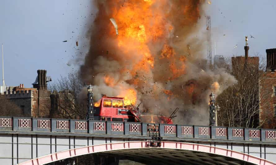 Bus explodes on Lambeth Bridge in London during filming for Jackie Chan's new film.