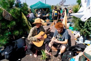 Climate change activists play music as Extinction Rebellion continues to block the road on Waterloo Bridge in London on 21 April .