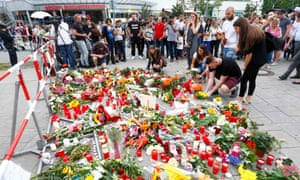 People lay flowers in front of the Olympia shopping centre in Munich on Saturday.