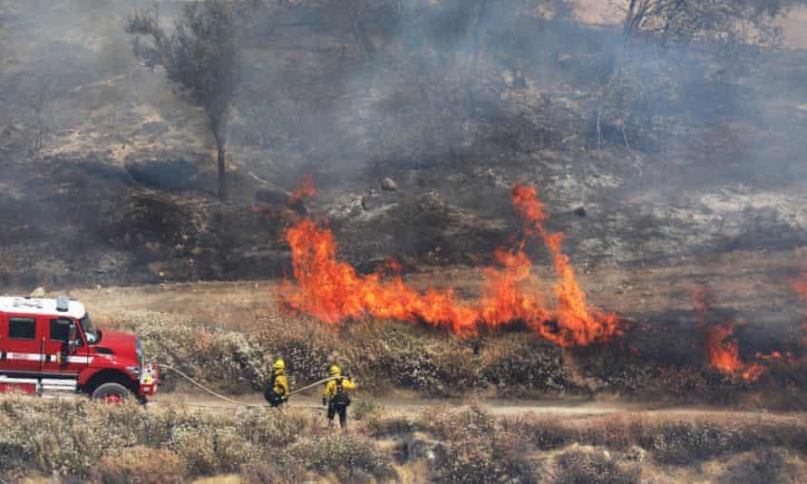 'Apple Fire' in Riverside County, California<br>epa08581237 Firefighters work to extinguish the 'Apple Fire', near Beaumont, in Riverside County, California, 02 August 2020. EPA/DAVID SWANSON