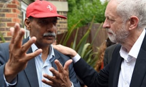 Corbyn meets a councillor, Mushtaq Lasharie, as he arrives at St Clement's church in west London, where volunteers have provided shelter and support for people affected by the fire at Grenfell Tower.