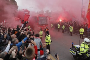 Liverpool supporters light flares as the bus carrying their team heads to the stadium