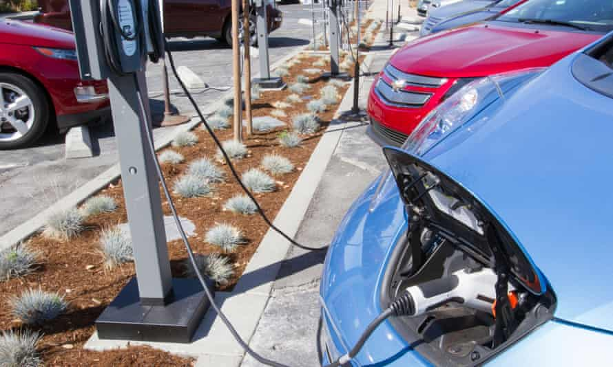 Electric cars plugged into a charging point