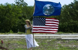 Kelda Miller of the United States protests with a national flag in front of the UN climate talks in Mexico, 2010.