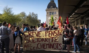 Striking French railway workers hold banners and placards as they gather in front of Matabiau station in Toulouse on 17 April 2018.