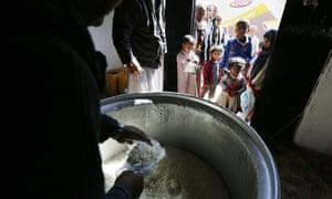 Food rations are distributed to people in Sana'a, Yemen