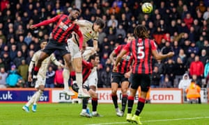 Harry Maguire of Manchester United beats Bournemouth's Jefferson Lerma to the ball but can't direct his header on target.
