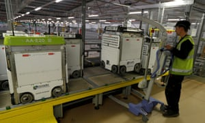 A technician prepares a 'bot' to be returned to the 'smart platform' at the Ocado customer fulfilment centre in Andover.