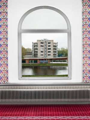 Mosque windows showing Dutch landscapes in the Netherlands by photographer Marwan Bassiouni.