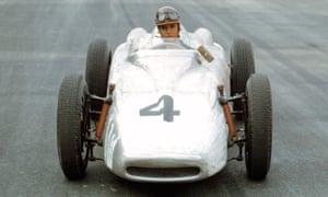 A woman driving a racing car