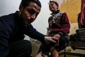 An injured child receives treatment