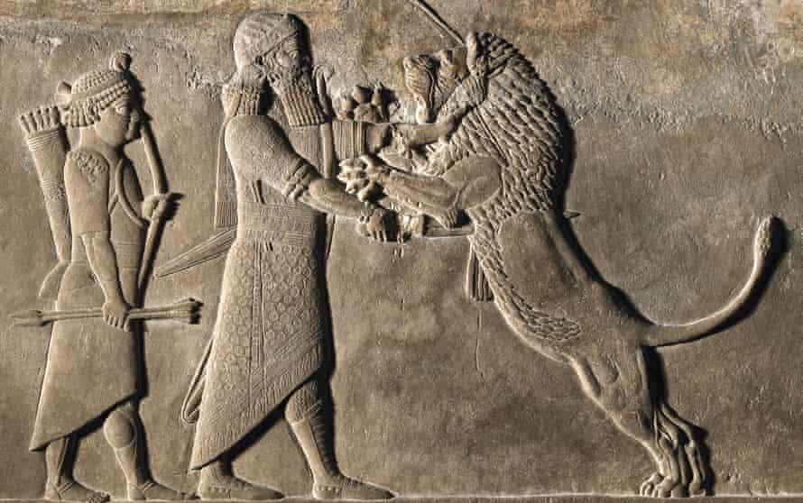 'They fought lions, to prove their superhuman virility' … Ashurbanipal in combat.