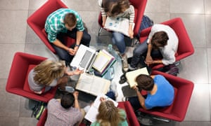 Students studying  in a circle