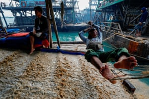 Scores of artisanal miners partner with PT Timah to exploit the state miner's concessions. The miners are paid about 70,000 to 80,000 rupiah ($4.90 to $5.60) per kg of tin sand they pump up, and a pontoon typically produces about 50 kg a day