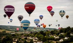 Hot air balloons fly over the Ashton Court estate, near Bristol