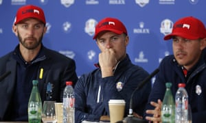Dustin Johnson, left, Jordan Spieth, centre, and Brooke Koepka look dejected during a press conference following USA's crushing defeat the Ryder Cup in Paris