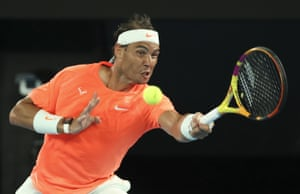 Nadal hits a forehand return to Tsitsipas