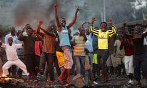Protestors chant anti-govenment slogans during clashes with riot police in Bujumbura in 2015.