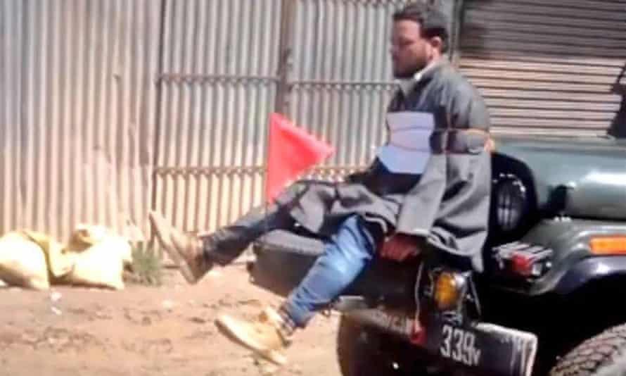 Farooq Ahmad Dar tied to an army vehicle