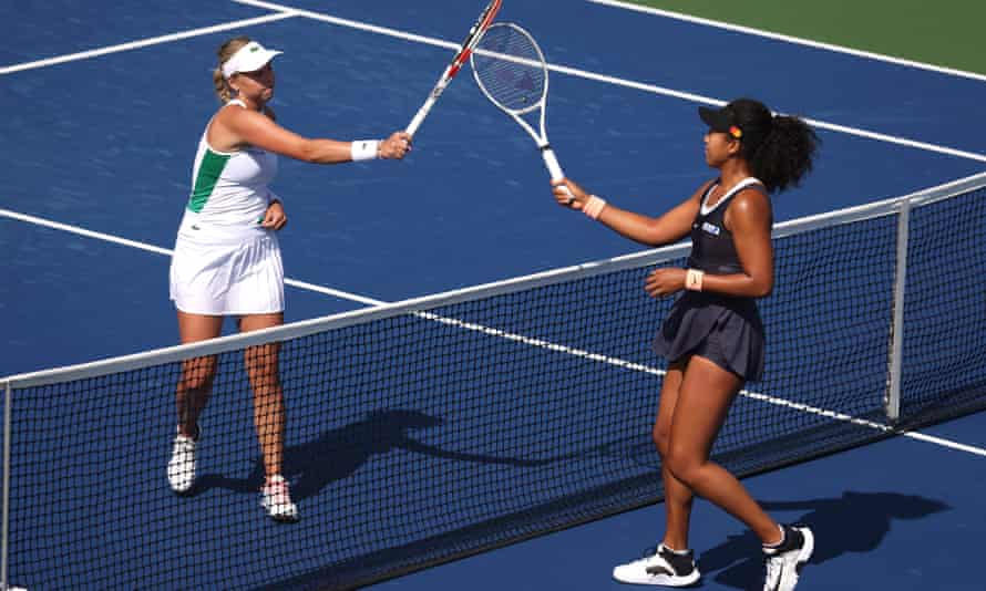 Naomi Osaka of Japan (right) greets Anett Kontaveit at the net after defeating her in three sets in their Western & Southern Open quarter-final.