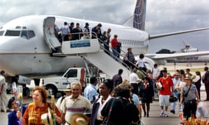 In this Nov. 1, 2001, file photo, the first passengers of the first flight of Continental Airlines from Miami Florida, arrives at the Jose Marti Airport of Havana, Cuba