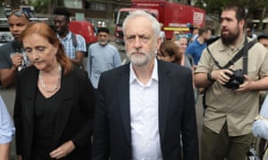 Emma Dent Coad, the newly elected MP for Kensington with Jeremy Corbyn at the scene of Grenfell Tower fire