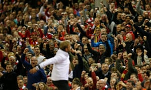 Juergen Klopp celebrates with the fans after the final whistle.