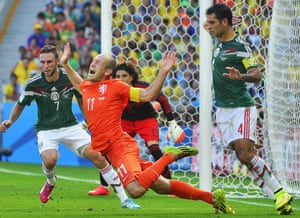 Arjen Robben of the Netherlands goes down in the box during the Fifa World Cup against Mexico, played in Brazil in 2014.