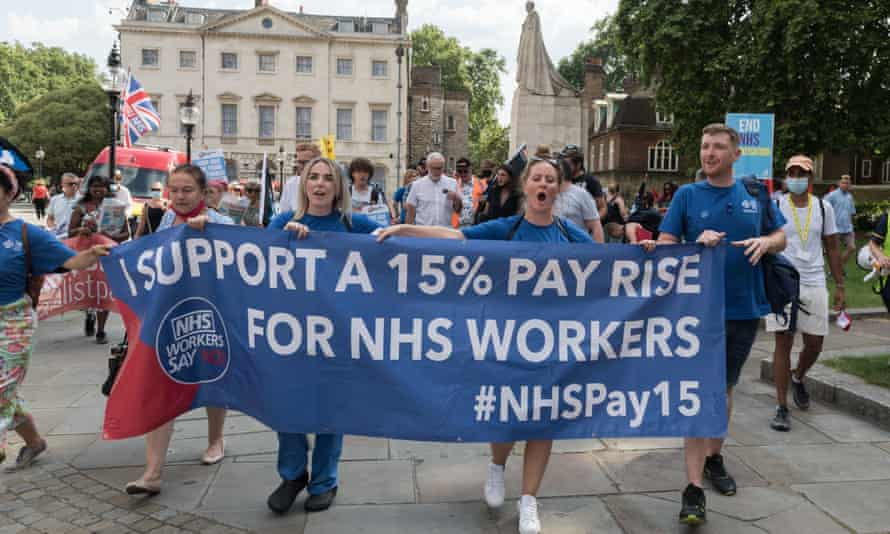 NHS staff, members of the trade unions and health campaigners takes part in a protest march through central London demanding 15% pay increase for health workers.