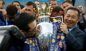 Vichai Srivaddhanaprabha and his son Aiyawatt Srivaddhanaprabha with the Premier League trophy in 2016.