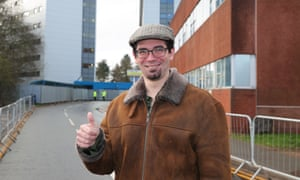 Matt Raw poses for a photo after leaving Arrowe Park hospital where he spent two weeks in quarantine.