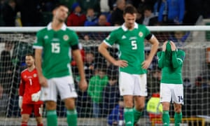Northern Ireland's players show their dejection after Austria's late winner.