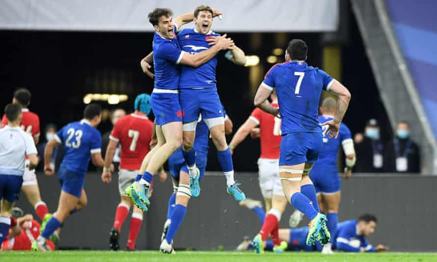 France's Teddy Thomas and Baptiste Serin celebrate Brice Dulin's late try that denied Wales the grand slam in Paris last Saturday.