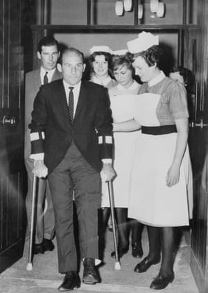 Stirling Moss leaving hospital in Wimbledon, south-west London, after the crash at Goodwood in April 1962 that brought an end to his racing career.