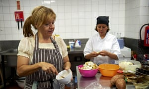 Marlith Tenazoa Del Aguila from Peru (right), and Roberta Siao from Brazil, prepare food in the kitchen at the Mazi Mas restaurant in Kennington, south London